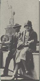 photo of the owner's Grandparents in front of the Statue of Liberty